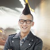 image of half-shaved hairstyle  - Young man with punk Mohawk smiling - JPG