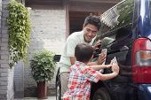 Father and Son Clean their Minivan Together