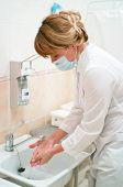 Health Occupation Worker Washing Her Hands