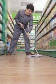 Caretaker Cleaning Floor in Supermarket
