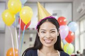 foto of office party  - Smiling Young Woman At Office Party - JPG