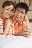 picture of button down shirt  - Young Couple Lying on Bed - JPG