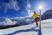 Skier, skiing, winter sport - woman has fun on ski