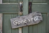 stock photo of signs  - Gone viral sign on old green doorway - JPG