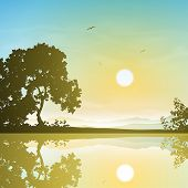 A Sunset, Sunrise Landscape with Trees and Reflection in Water