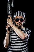Mutiny, Prison riot concept. Man holding a machine gun, prisoner