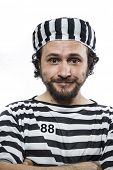 Illegal, Desperate, portrait of a man prisoner in prison garb, over white background