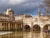 stock photo of avon  - Completed in 1774 designed by Robert Adam in a Palladian style Pulteney Bridge crosses the River Avon in Bath England UK Europe - JPG