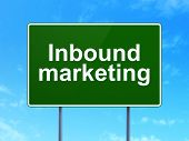 Finance concept: Inbound Marketing on road sign background