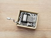 stock photo of gizmo  - Old little music box on a wooden background - JPG
