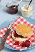 Scone With Clotted Cream And Raspberry Jam