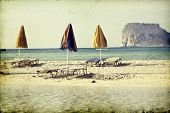 Vintage photo of beautiful beach with umbrellas and sunbeds