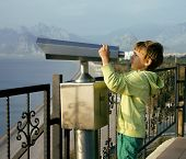 little cute boy looking through telescope at sea viewpoint in Ataturk park
