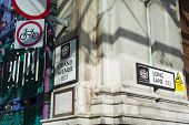 LONDON, UK - FEBRUARY 16, 2014: Street signs in the nearly one thousand years old Smithfield market.
