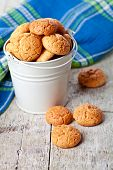 meringue almond cookies in bucket on wooden background