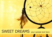 foto of dream-catcher  - Beautiful dream catcher on yellow background - JPG