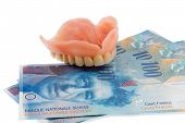 dentition and the swiss franc symbol photo for dentures, treatment costs and payment