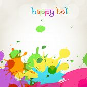 Indian colour festival Happy Holi celebrations concept with grungy colour splash on abstract background.