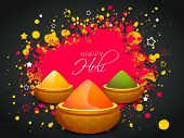 Indian festival Happy Holi celebrations concept with shiny colour powders on splash background.