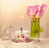 Colorful tea cup,pink tulips