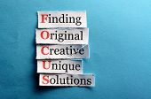 foto of paper cut out  - Focus acronym in business concept words on cut paper hard light - JPG