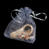 Gold Jewelry In Pouch On Black Background