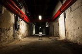 stock photo of basement  - inside an old industrial building basement with little light - JPG