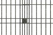 image of jail  - Metal Jail bars isolated on a white background - JPG