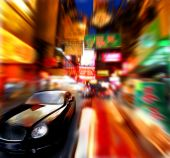 stock photo of luxury cars  - luxury car running in a shopping chinese street - JPG