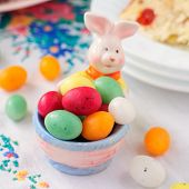 Easter Bunny Egg Holder Filled With Colorful Spotted Egg-shaped Candies