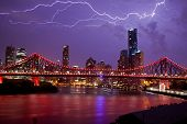 stock photo of cbd  - Lightning striking over Brisbane City and the Story Bridge - JPG