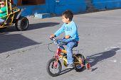 Boy on Bike in Banos, Ecuador