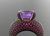 Golden Ring with Diamond. Jewelry background. Amethyst