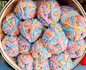 baby blanket yarn in a round basket