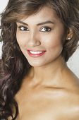 Beautiful smiling young woman face head and shoulders
