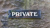 Private Sign On A Stone Wall
