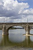 Ancient bridge of Saumur in Loire River, France