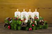 Advent Wreath Or Crown With Four Burning White Candles.