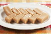 stock photo of toffee  - Toffee candies on a plate closeup shot - JPG