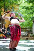 MUSKOGEE, OK - MAY 24: A woman dressed as Gypsy dances at the Oklahoma 19th annual Renaissance Festi
