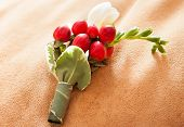 stock photo of boutonniere  - elegant green and red grooms wedding boutonniere