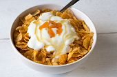 Cornflakes In A Bowl With Yogurt And Honey