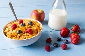 Cornflakes In A Bowl With Milk And Fruits