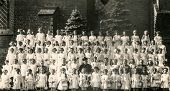 SIERADZ, POLAND, CIRCA FIFTIES - Vintage photo of group of little girls with priests and nuns at the