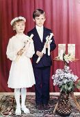 SIERADZ, POLAND, CIRCA EIGHTIES - Vintage photo of brother and sister at their First Communion