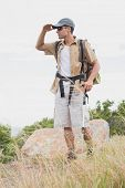 Full length of a hiking man walking on mountain terrain