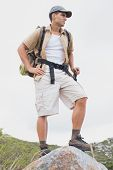 Full length of a hiking man standing on mountain terrain