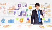 Young businessman analyzing data information of market