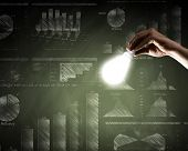 Conceptual image with light bulb diagrams and graphs