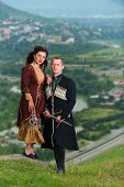 Man And Woman In Georgian National Dress.